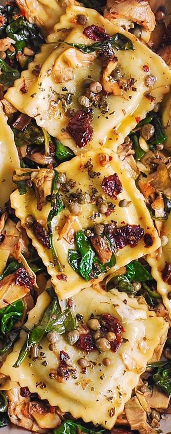 Ravioli with Spinach, Artichokes, Capers, Sun-Dried Tomatoes. Vegetables are sauteed in garlic and olive oil. #Italian #Mediterranean #pasta #dinner