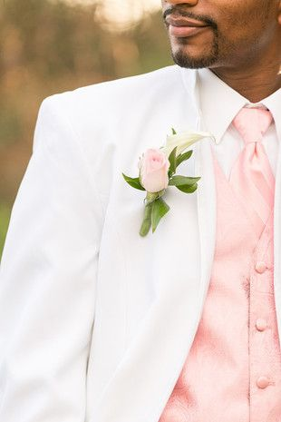 15 of Our Favorite Summer Weddings: This groom wore a white suit accessorized with a blush necktie, vest and pink rose boutonniere {Kirstyn Marie Photography}