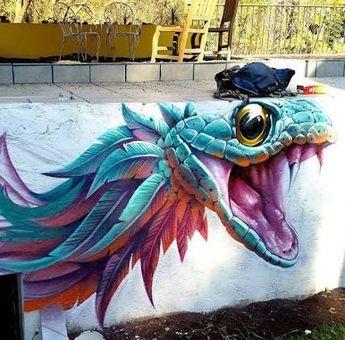 Amazing feathered snake street art