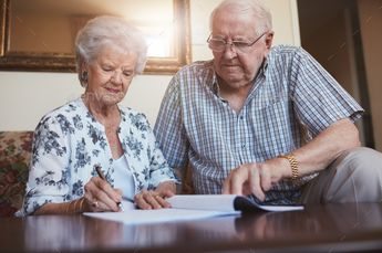 Senior couple doing retirement paperwork by jacoblund. Indoor shot of mature couple at home signing documents together. Senior man and woman sitting on sofa doing retiremen...#Indoor, #jacoblund, #mature, #shot