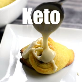 Easy Keto Low-Carb Fathead Cinnamon Rolls with Icing is a quick, gluten-free recipe that uses almond flour, mozzarella, and cream cheese to produce gooey buns! It also includes the recipe for sugar-free glaze. These rolls have 3 grams of carbs and are wonderful for breakfast or dessert! You can even go for a cream cheese frosting instead of icing! #KetoRecipes #KetoDessert #KetoCinnamonRolls