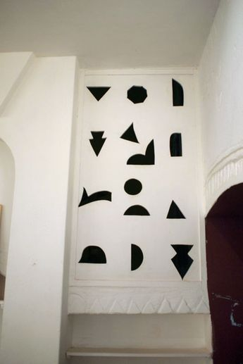 jessica williams / holes cut in the wall in Khartoum, Sudan to let air flow freely