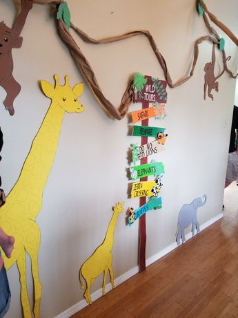 WILD ONE birthday party. Animals made from poster board. Vines are craft paper roll from dollar store.
