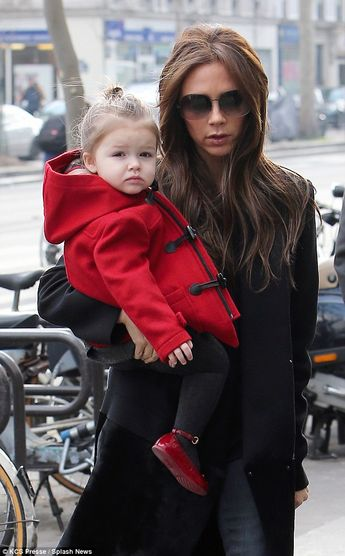 Harper Beckham with Victoria..that little one is the cut