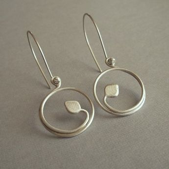 ...Delicate and whimsical, yet completely modern... Brushed (matte finish) sterling vines and leaves wrap around themselves, forming small hoops dangling from handmade french ear wires. Currently out of stock, these earrings take approximately a week to make. Arrives at your door in a