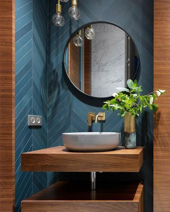 Would be cool to see the half bath with the dark slate flooring, the black walnut vanity and some amazing teal color on the walls...