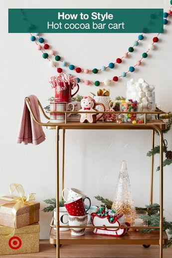 Turn a bar cart into a hot chocolate station with fun holiday mugs & all the sweetest toppings.