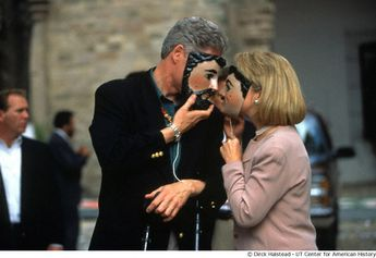 President Clinton and First Lady Hillary Rodham Clinton see mask-to-mask during a trip to Mexico.  -- 1998