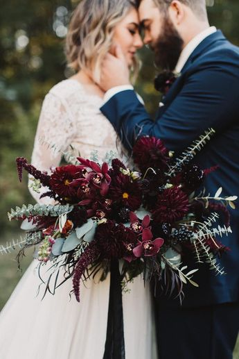Burgundy wedding flowers by Pomp&Bloom. Image by Courtney Sinclair Photography.