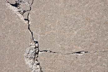 Solved! What to Do About Cracks in a Concrete Driveway