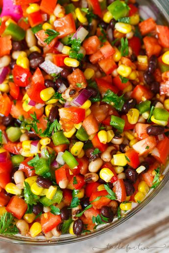 The most colorful salad you will have at your next party or barbecue! Cowboy caviar is like a mashup between salsa and beans. Salsa and beans had a baby and named it cowboy caviar because it's just so hearty and richly delicious!