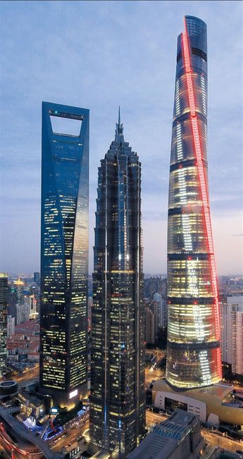 The Shanghai Tower in the Lujiazui financial hub is lit up in red and white lights yesterday. The tower in Pudong New Area was testing its lighting system as it gears up to mark the New Year's Eve next week.