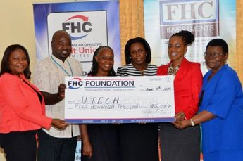 Executives of the University of Technology (UTech) with a representational cheque for $500,000, which was presented by First Heritage Co-operative Credit Union to implement a pilot business education and entrepreneurship project in five high schools in the Corporate Area. The cheque was presented at the official launch of the project on Tuesday, June 4, at UTech's Papine campus in St. Andrew. At second right is: Senior Marketing Officer, First Heritage Co-operative Credit Union, Diana Allen....