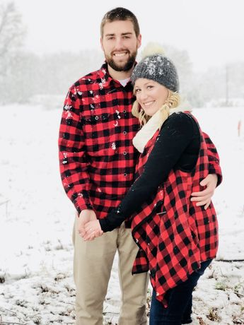 Rustic Christmas engagement photos in the snow