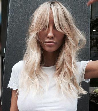 Blonde hair. Loose bangs. How do these bangs look SO GOOD.