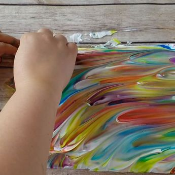 Make some pretty shaving cream marbled paper. Fun kids craft art project to make! Pretty rainbow designs