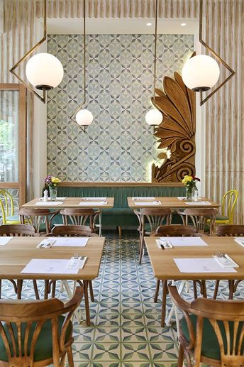 Thessaloniki-based architects Minas Kosmidis have designed a chic neighbourhood restaurant in Athens for first-time restaurateur Ntoumis Konstantinos who, after years of managing eateries for other owners, has struck out on his own. Located in the affl...
