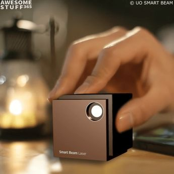 If you think that the UO Smart Beam Mini Portable Projector is anything like a blurry dusty projector youre used to seeing in classrooms think again.  This high-tech gadget looks like it comes straight from the future. Or at least from Tony Starks Malibu mansion (which was destroyed but thats beyond the point). This portable high-quality projector manages to be as compact as possible without sacrificing the sharpness of the displayed picture. #technology #technology #videos