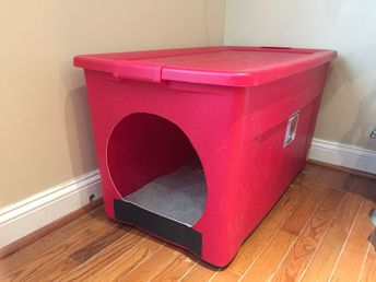 Homemade litter box from a large storage container. Made for our large cat that had problems with smaller litter boxes. #CatFurniture