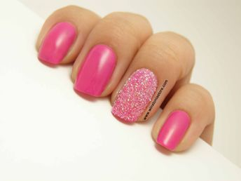 Pink nails with standout glitter powder ring finger...x