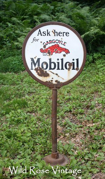 Die-cut Lollipop sign for Mobiloil showing a large Pegasus,