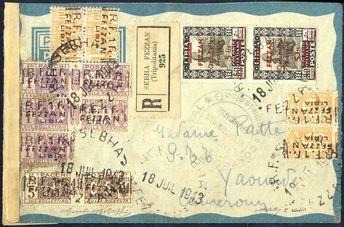 Fezzan 1943, lettera aerea raccomandata da Sebha il 18.7. per Yaounde (Cameroun) affrancata con coppia del 5 f. su 50 c. Pittorica e Pacchi Postali interi da 1f. su 5 c. e coppia verticale di 1f. su 1l. e 4 metà del 1 f. su 50 c. e due 1f. su 1l. dei quali uno sul verso, firmata per esteso Giulio Bolaffi, Sass. 7, PP13,15, 16 / 88550,-