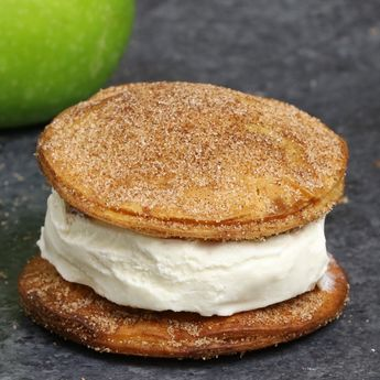 Apple Pie Ice Cream Sandwiches - Delicious cinnamon sugary apple pie with ice cream in between. A super easy treat using flour tortillas and comes together in no time! All you need is a few simple ingredients: Flour Tortillas, butter, cinnamon, sugar, apples, lemon, egg and ice cream. Quick and easy recipe.