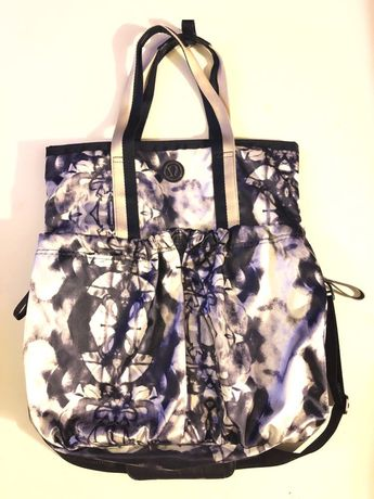 Excellent Used Condition   Perfect everyday tote/laptop bag! Multiple compartments for laptops, yoga mats or anything else you can fit!   Work only handful of times — this bag still includes the smaller makeup bag inside as well as the longer strap to wear crossbody style   Minor wear at corners — not noticeable (Picture quality will be improved)   Color: Inkblot  ••• Last picture is just for reference and shows if it was worn as a crossbody — item sold is Inkblot •••