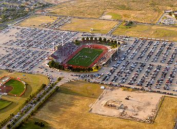 Yep, that's a high school stadium. Ratliff Stadium, home of Permian and Odessa High School football.  I spent many Friday nights back in the 80s rooting for the Panthers.  MOJO!  (Notice the pumpjack in the foreground.)  Although it appears to be in the middle of nowhere, Odessa (pop. 102,000 or so) is only a mile or two away.