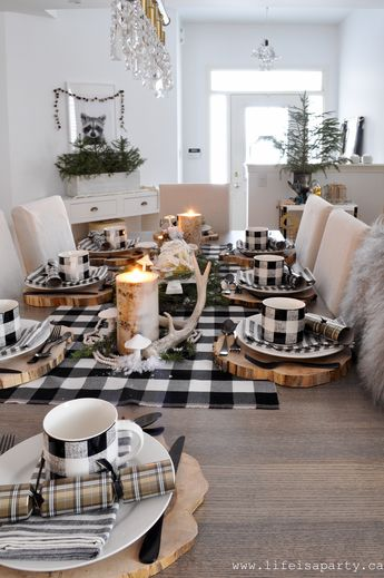 Rustic Black and White Christmas Table -wood chargers, a chocolate birch bark yule log cake, and handmade clay mushrooms make this woodsy table special.