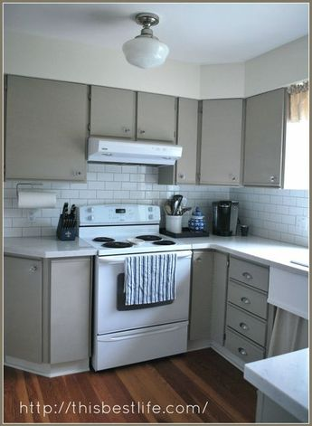 Kitchen makeover: redo over 80s melamine and oak trim cabinets...chalk paint redo! So happy with the results