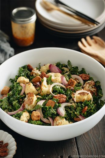 Dressed with creamy and savory miso tahini dressing, this Roasted Cauliflower Kale Salad is packed with delicious caramelized cauliflower, kale, sweet glazed pecans, and crunchy croutons. It's a nutritious, filling, welcome addition to the holiday table. #roastedcauliflower #kalesalad   Easy Japanese Recipes at JustOneCookbook.com