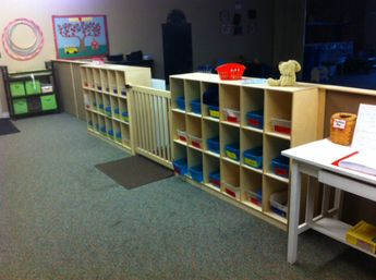 Preschool room divider with gate and cubbies. If we could get shorter cubbies, then I would be able to easily see over them to moniter both sides of the room.