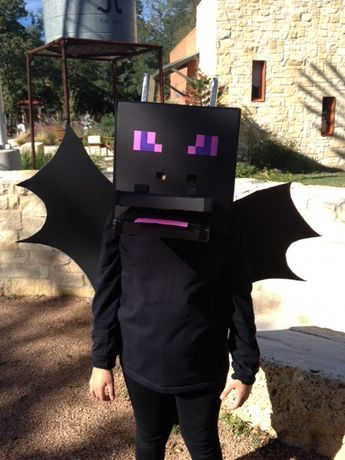 Ender dragon costume. The head was made from black foam board cut to size in the shape of a cube. Glued together with hot glue. Eyes were painted. Mouth foam board. Nostrils are foam board wrapped in duct tape.