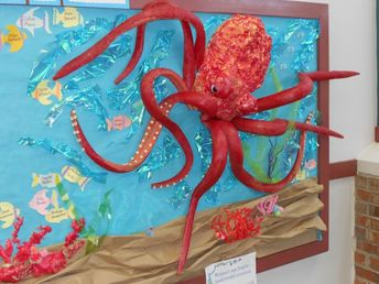 Under the Sea theme Bulletin Board. Octopus made with pool noodles and spray foam insulation.