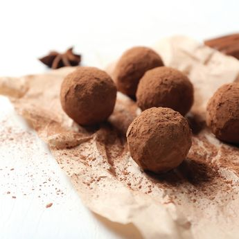 CHOCOLATE TRUFFLES    1/2 cup 80% dark chocolate chips  1 tbsp. almond butter 1/4 cup Greek yogurt 1/3 cup Cacao Bliss or raw cacao   Melt chocolate chips in the microwave at 20 sec intervals or on a double boiler over the stove. While the chocolate is warm, stir in almond butter & mix until combined well. Carefully fold in yogurt, mix well, & refrigerate for 15 minutes or until it starts to harden. Scoop 1 tbsp & form truffles into a ball, roll in raw cacao, & refrigerate until ready to serve.