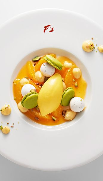 Along the tourist-filled sidewalk of the Champs Elysees, the famous cafe-restaurant Fouquet's will begin serving a new menu of modern French dishes. Created by the three-star chef Pierre Gagnaire and executed by chef Jean-Yves Leuranguer, the new dishes are light and playful. (Photo: Laurent Fau)