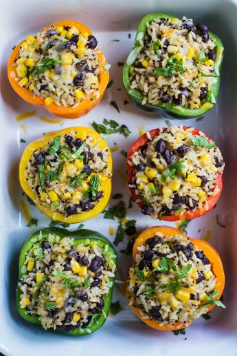 Burrito Bowl Stuffed Peppers- this recipe is VEGAN, super easy to make, and perfect for dinner or leftover lunches!! Something the whole family will love. #healthyvegetarianrecipes