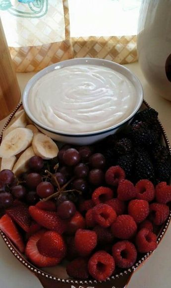 Fruit Dip - beat the following until smooth :  8 oz. cream cheese, softened  2 containers (6 oz. each) vanilla yogurt  1 c. confectioners sugar  1 Tbsp. vanilla extract  SO good .. would taste even better with some vanilla bean :)