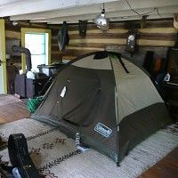During a power outage, set up a tent indoors to conserve heat and raise interior temperature