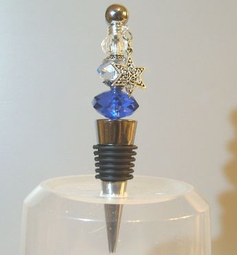 HANUKKAH Wine Bottle Stopper. A Star of David charm adorns this piece of table jewelry. It features sapphire, aquamarine and clear crystals flanked with filligree bead caps. Add'l colors | via ETSY <3