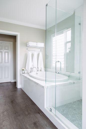 """Hardwood"" Tiles and marble floor.  Towel rack - restoration hardware"