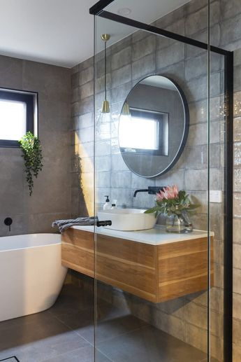 Denman Prospect Residence - Studio Black Interiors. A modern bathroom, with black fixtures, floating timber and stone vanity, and textured light grey tiles in a stack pattern. Built by Homes by Howe. Photography by HCreations. #amodernbathroom