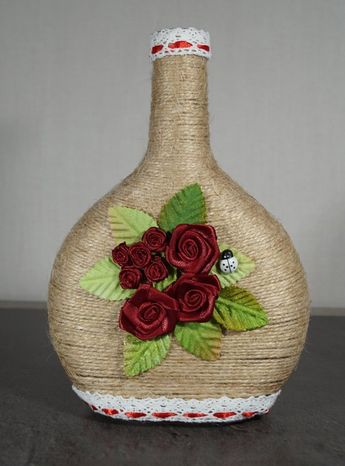 Bottles,bottle decor, wine bottle decor, decorated wine bottles, home wine bottle decor, custom wine bottle, twine wrapped wine bottles, wine bottle art, wine bottle craft,decoreted bottles,home decor gift This wine bottle has been wrapped with brown twine and adorn with flowers in cloth.