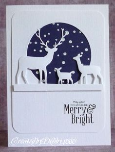 handmade winter/Christmas card from A Scrapjourney ... die cut deer family in front of negative cut circle ... navy sky filled with white snowflake circles ... like the way Debby grounded them on a raised strip ... luv it!!