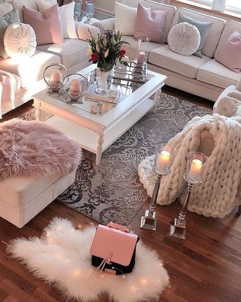 Wooden floors, white furniture and lots of pink. Oh yeah.