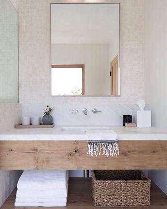 Bathroom design with wood vanity and white marble backsplash | Simo Design.
