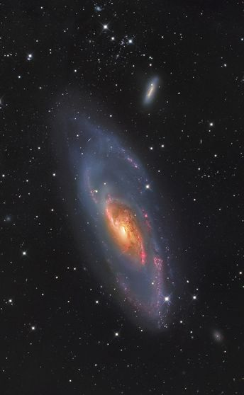 M106 Messier 106 is a spiral galaxy in the constellation Canes Venatici. It was discovered by Pierre Méchain in 1781. M106 is at a distance of about 22 to 25 million light-years away from Earth. It is also a Seyfert II galaxy. Credit: Bill Synder...