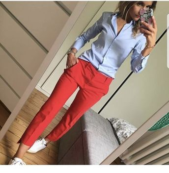 Blue shirt and red pants