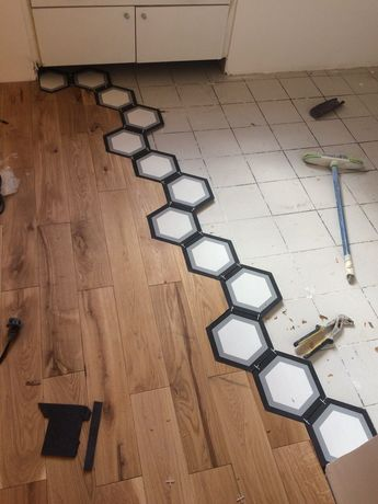 36 Marble Tiles Meeting the Wooden Floor
